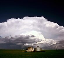 Storm clouds over Saskatchewan granaries by pictureguy