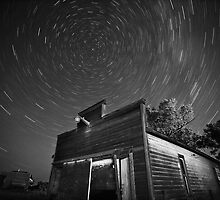 Star tracks over old abandoned garage in Saskatchewan by pictureguy