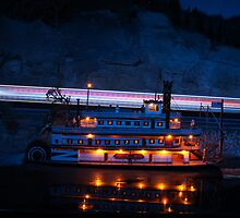 Paddle Boat With Train Light Stream  by Tina Hailey