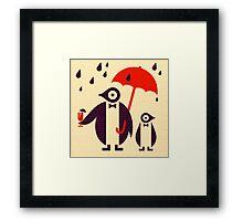 Penguins Keeping Dry Framed Print