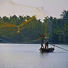 Vietnam. Hoi An River. Fisherman Throwing a Net. by vadim19