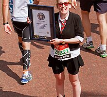 A guinness world record holder for running the london marathon in school uniform by Keith Larby