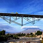The Biker crossing the Bridge... and the Volcano  by Alessandro Pinto