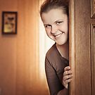 Beautiful Girl Peeking Behind The Door by GrishkaBruev