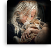Girl cuddles Rabbit Canvas Print