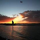 Currumbin Sunset With Jet Liner by Noel Elliot