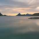 Sunset over fjord shore in Norway by DmiSmiPhoto