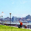 Flying a Kit at Pier A Park Hoboken NJ by Susan Savad