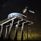 Stars with windmill and tank in foreground by MileCreations