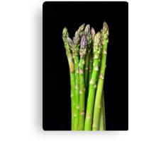 Green asparagus on black Canvas Print