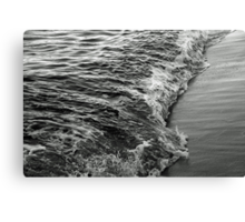 Lapping the shoreline Canvas Print