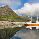 Small fishing boat in the harbor of the fjord by DmiSmiPhoto