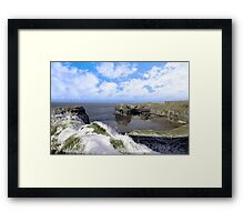 frosty snowcovered coastal beach view and virgin rock Framed Print