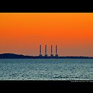 National Grid Power Plant Chimneys Against Golden Evening Sky - Asharoken, New York  by © Sophie Smith