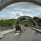 Boat Transiting the Falkirk Wheel in Scotland by Gerda Grice