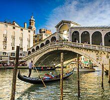 Gondola at the Rialto bridge in Venice by Michael Abid