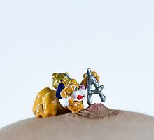 miniature toy measuring woman's nipple  by PhotoStock-Isra