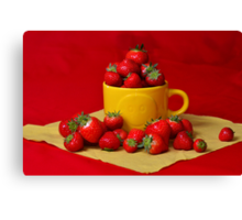 Strawberries in a sunny cup Canvas Print