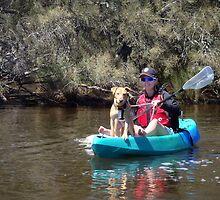 Dog on kayak by BigAndRed