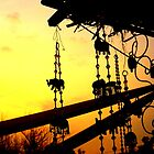 Sunset and wind chimes by redscorpion