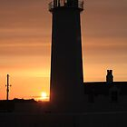 sunset over walney lighthouse by kip13