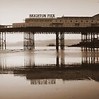 Spring tide at Brighton Pier by plcimages