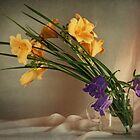 still life of yellow lilies and purple buds by Sviatlana Kandybovich