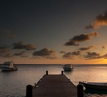 Sunset from the jetty - Bonaire by Ralph Goldsmith