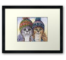 The knitwear cat sisters in hats Framed Print