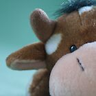 Close up of toy cow by Ekl75
