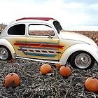 Old Bug Car in a field with pumpkins. by Barberelli