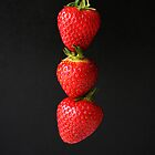 Strawberries On Black by Alan Harman