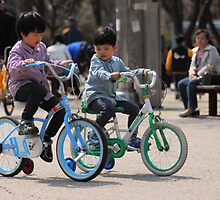 2 Brothers Learning to Ride Bikes (2) by Christian Eccleston