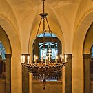 Arches and a Chandelier in the Banff Springs Hotel, Alberta, Canada by Gerda Grice