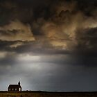 Storm light on Kirkja by Karen Scrimes