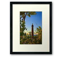 Little Sable Lighthouse seen through the Trees Framed Print