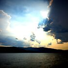 Sun bursts through the clouds by DelisaCarnegie