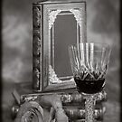 Glass of Wine with a Good Book by mlphoto