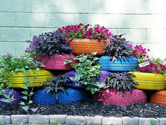 Painted tires brightly colored tire planters flowers by - Painted tires for flowers ...