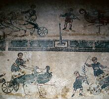 Birds drawing chariots in races childrens room, floor mosaic Piazza Armerina 198403260070  by Fred Mitchell