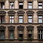 Facade of an old grey building in East Berlin by Reinvention