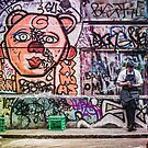 Chef Takes a Break in a Lane Covered in Street Art by jamjarphotos
