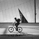 Cyclist and Pedestrian Travel in the Same Direction at Melbourne Museum by jamjarphotos