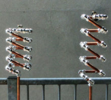 Copper and Chrome Slinki Tiki Torch - FredPereiraStudios.com_Page_01 Sticker