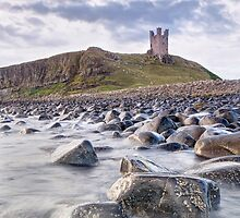Dunstanburgh Castle Boulders by Chris Frost Photography