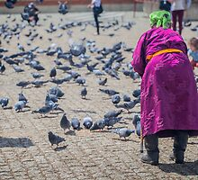 Feeding the pigeons at Gandan Monastery by Ruben D. Mascaro