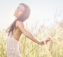 Pretty Young Woman in Grass Meadow by visualspectrum