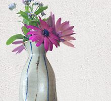 A posy in a sake bottle by Clare Colins