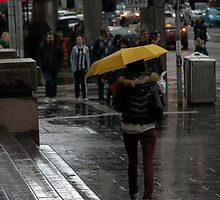 Rain, a Collingwood vest and a tram sign by claireh