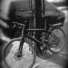 bicycle under the snow in Paris by Peter75